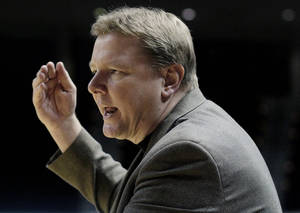 Photo - FILE - In this Feb. 19, 2011 file photo, Oklahoma State women's basketball coach Kurt Budke makes a point during the second half of an NCAA college basketball game against Texas A&M,  in College Station, Texas. Oklahoma State University says  Budke and assistant coach Miranda Serna were killed in a plane crash in central Arkansas. The university said in a news release Friday, Nov. 18, 2011 that the two were on a recruiting trip to Arkansas when the plane crashed near Perryville, about 45 miles west of Little Rock. (AP Photo/Pat Sullivan, File) ORG XMIT: NY153