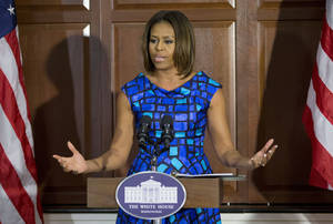 Photo - First lady Michelle Obama speaks to school leaders and experts surrounding school nutrition, Tuesday, May 27, 2014, in the Eisenhower Executive Office Building on the White House complex in Washington. The meeting provided an opportunity for the Michelle Obama to hear directly from them about the work they are doing to improve school nutrition in their local districts. She stressed the importance of students, parents, school officials, community leaders, and health advocates coming together to protect and advance the tremendous progress that has been made in schools across our country. (AP Photo/Pablo Martinez Monsivais)