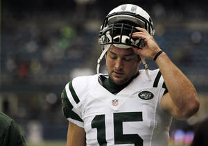 photo - FILE - This Nov. 11, 2012 file photo shows New York Jets' Tim Tebow on the field before an NFL football game against the Seattle Seahawksin Seattle. Rex Ryan acknowledged Wednesday, Dec. 19, 2012 that he had higher expectations for the seldom-used Tebow in the Jets' wildcat-style offense. And, so did the NFL's most popular and maligned backup quarterback. (AP Photo/Elaine Thompson, File)