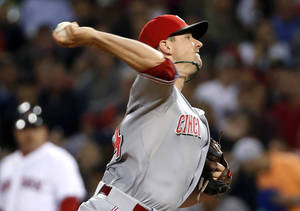 Photo - Cincinnati Reds starting pitcher Mike Leake delivers to the Boston Red Sox during the sixth inning of a baseball game at Fenway Park in Boston, Wednesday, May 7, 2014. (AP Photo/Elise Amendola)
