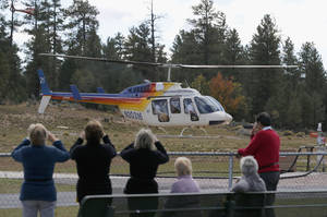 Photo - Hundreds of tourists flock to Grand Canyon Airport to take helicopter and plane tours as the only way they could see the Grand Canyon as the entrance to Grand Canyon National Park remains closed to visitors due to the continued federal government shutdown on Friday Oct. 11, 2013, in Tusayan, Ariz. (AP Photo/Ross D. Franklin)