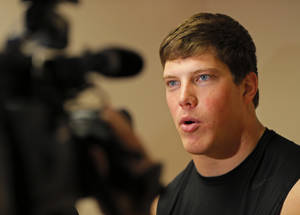 Photo - OSU / COLLEGE FOOTBALL:  OSU's Cooper Bassett talks to the media after football practice at Oklahoma State University in Stillwater, Okla., Friday, Dec. 14, 2012. Photo by Nate Billings, The Oklahoman