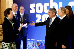 Photo - International Olympic Committee member Princess Anne of Great Britain, left, greets Russian President Vladimir Putin, right, IOC President Thomas Bach, second from right, and Sochi 2014 Olympics President Dmitry Chernyshenko, second from left, at an event welcoming IOC members ahead of the upcoming 2014 Winter Olympics at the Rus Hotel, Tuesday, Feb. 4, 2014, in Sochi, Russia. (AP Photo/David Goldman, Pool)
