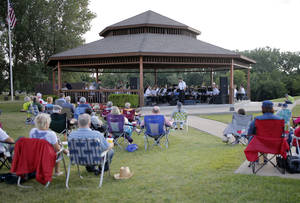 Visitors watch the Oklahoma City Symphonic Band play during a concert in the park at Chisholm Trail Park in Yukon. Photo by Sarah Phipps, The Oklahoman  <strong>SARAH PHIPPS -   </strong>