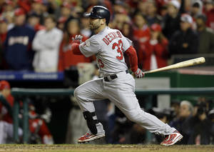 Photo -   St. Louis Cardinals' Daniel Descalso singles in the ninth inning of Game 5 of the National League division baseball series against the Washington Nationals on Saturday, Oct 13, 2012, in Washington. Carlos Beltran and Adron Chambers scored on the play. (AP Photo/Pablo Martinez Monsivais)