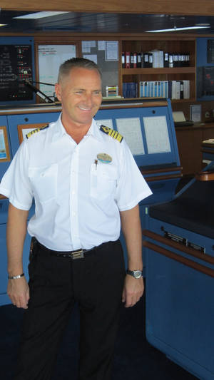Photo - Captain Frank Martinsen is seen on the bridge of the Navigator of the Seas. <strong> -  Richard Darnell </strong>