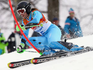 Photo - Slovenia's Tina Maze skis past a gate in the first run of the women's slalom at the Sochi 2014 Winter Olympics, Friday, Feb. 21, 2014, in Krasnaya Polyana, Russia. (AP Photo/Alessandro Trovati)