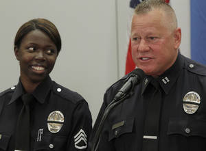 photo - Husband and wife, Sgt. Emada Tingirides and Capt. Phil Tingirides speak during a news conference Tuesday Feb. 19, 2013 in Los Angeles. The couple discussed the issue of racism in the LAPD. Capt. Phil Tingirides, headed the three-person disciplinary panel that unanimously decided Christopher Dorner should be fired for making a false report. The family's six kids plus a daughter's boyfriend were under police protection for six days. (AP Photo/Nick Ut)