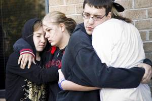Photo - Samantha Ritz, Marissa Hutton, Daniel Flynn and Stephanie Spehar gather to support each other during a vigil for Carina Saunders, whose body was found in a duffel bag last week, on Tuesday, Oct. 18, 2011. in Bethany, Okla. Photo by Chris Landsberger, The Oklahoman  ORG XMIT: KOD
