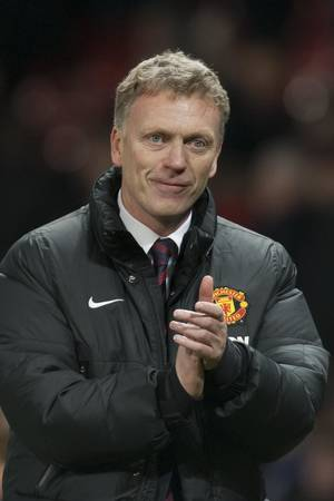 Photo - Manchester United's manager David Moyes applauds supporters after his team's 2-0 win against Swansea City in their English Premier League soccer match at Old Trafford Stadium, Manchester, England, Saturday Jan. 11, 2014. (AP Photo/Jon Super)
