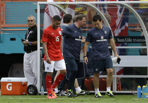Photo - England's Alex Oxlade-Chamberlain (15) walks off the field after he was expelled in the second half of a friendly soccer match against Ecuador in Miami Gardens, Fla., Wednesday, June 4, 2014. The game ended in a 2-2 tie. (AP Photo/Alan Diaz)