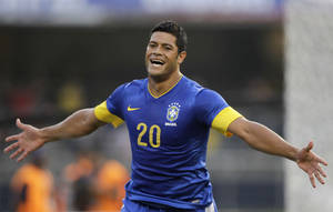 Photo -   Brazil's Hulk celebrates after score a goal during a friendly soccer match against South Africa in Sao Paulo, Brazil, Friday, Sept. 7, 2012. (AP Photo/Nelson Antoine)