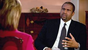 "Photo - This undated image from video released by PBS shows host Tavis Smiley, right, during an interview with Hillary Rodham Clinton on ""Tavis Smiley Reports."" Smiley, who's marking his 10th year this month as host of his PBS talk show and his 20th year in broadcasting. (AP Photo/PBS)"