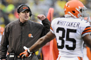 Photo - Cleveland Browns head coach Rob Chudzinski, left, looks to an official along with running back Fozzy Whittaker (35) in the second quarter of an NFL football game against the Pittsburgh Steelers, Sunday, Dec. 29, 2013, in Pittsburgh. The Steelers won 20-7. (AP Photo/Don Wright)