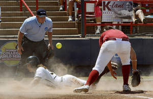 Photo - Missouri's Ashley Fleming (30) slides home as Oklahoma's Keilani Ricketts (10) goes for the ball in the sixth inning of a Women's College World Series softball game between the University Oklahoma and Missouri at ASA Hall of Fame Stadium in Oklahoma City, Saturday, June 4, 2011. Missouri won, 4-1. Photo by Bryan Terry, The Oklahoman