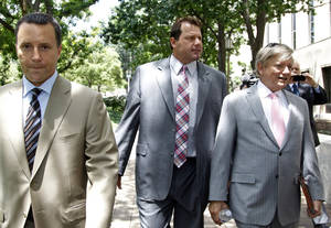 Photo -   Former Major League Baseball pitcher Roger Clemens, center, and his attorneys, Rusty Hardin, right, and Michael Attanasio arrive at federal court in Washington, Wednesday, June 13, 2012. (AP Photo/Haraz N. Ghanbari)