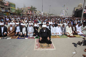 Photo - Followers of radical Shiite cleric Muqtada al-Sadr attend Friday prayers in the Sadr City neighborhood in Baghdad, Iraq, Friday, April 5, 2013. (AP Photo/Karim Kadim)