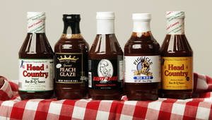 Photo - These  barbecue sauces were gathered from stores in Oklahoma. From left  are Head Country original, Peach Crest Farms peach glaze, Hasty Bake, Pigcicle Sauce and Head Country spicy.  Photo by K.T. KING, The Oklahoman <strong>KT King - KT KING</strong>