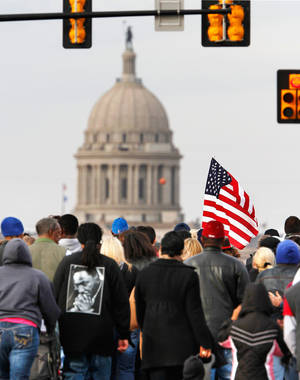 Photo - About 100 men, women and children participated in the Silent March, walking from the Freedom Center on N. Martin Luther King Avenue. then west on  NE 23 Street  to the Oklahoma History Center for speeches and a bell ringing ceremony; the march and bell ringing ceremony were among events in the Oklahoma City area that allowed local residents to observe the national holiday honoring slain civil rights leader, Dr. Rev. Martin Luther King, Jr. on Monday, Jan. 16,  2012,    Photo by Jim Beckel, The Oklahoman