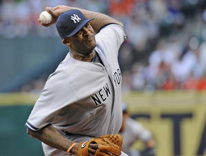 Photo - FILE - In this Tuesday, April 1, 2014 file photo, New York Yankees' CC Sabathia delivers a pitch against the Houston Astros in the first inning of a baseball game on opening day in Houston. Any hopes the New York Yankees had of CC Sabathia returning to their ravaged rotation this year are over. General manager Brian Cashman says Sabathia will have season-ending surgery on his right knee Wednesday, July 23, 2014. Cashman says indications are the left-hander will be ready for spring training next year, but there are no guarantees (AP Photo/Pat Sullivan, File)