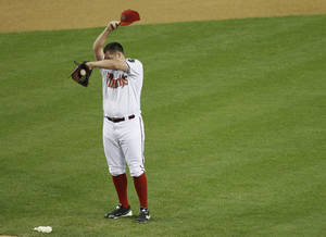 Photo -   Arizona Diamondbacks pitcher Bryan Shaw wipes his brow after giving up back-to-back home runs against the St. Louis Cardinals during the seventh inning of a baseball game Monday, May 7, 2012, in Phoenix. (AP Photo/Matt York)