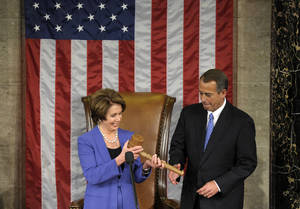 photo - House Minority Leader Nancy Pelosi of Calif. passes the gavel to House Speaker John Boehner of Ohio, who was re-elected as House Speaker of the 113th Congress, Thursday, Jan. 3, 2013, on Capitol Hill in Washington. (AP Photo/Susan Walsh)