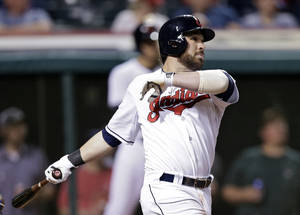 Photo - Cleveland Indians' Jason Kipnis watches his two-run home run off Kansas City Royals starting pitcher Jeremy Guthrie in the sixth inning of a baseball game Monday, April 21, 2014, in Cleveland. (AP Photo/Mark Duncan)