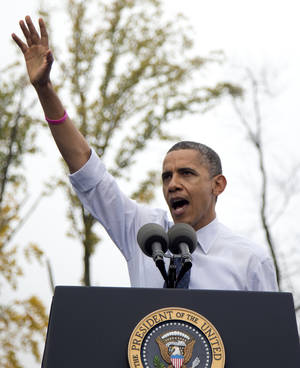 photo -   President Barack Obama gestures while speaking about the choice facing women in the upcoming election, Friday, Oct. 19, 2012, at a campaign event at George Mason University in Fairfax, Va. (AP Photo/Carolyn Kaster)