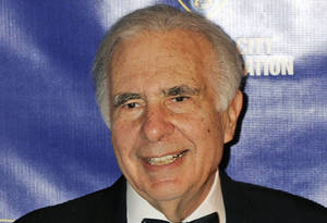 Photo - FILE - In this March 16, 2010 file photo, financier Carl Icahn poses for photos upon arriving for the 32nd annual New York City Police Foundation Gala in New York. Under a deal announced Thursday, April 10, 2014, Icahn is backing down from his push to remake eBay, settling an acrimonious dispute just ahead of what promised to be an awkward annual shareholders meeting. (AP Photo/Henny Ray Abrams, File)