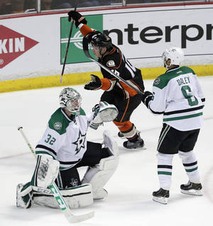 Photo - Anaheim Ducks' Corey Perry, center, celebrates his goal as he skates past Dallas Stars goalie Kari Lehtonen, left, of Finland, and Stars' Trevor Daley during the second period in Game 2 of the first-round NHL hockey Stanley Cup playoff series, Friday, April 18, 2014, in Anaheim, Calif. (AP Photo/Jae C. Hong)