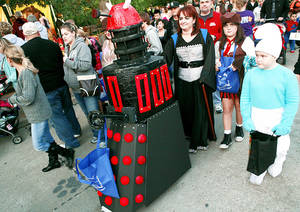 CHILD / CHILDREN / KIDS: Dressed as a Dalek from the television show Dr. Who, Riley McCue, of Edmond, visits Haunt the Zoo with her parents Amy and Michael and her sister Raechell, at the Oklahoma City Zoo in Oklahoma City on Sunday, Oct. 30, 2011. Photo by John Clanton, The Oklahoman Archives <strong>JOHN CLANTON - John Clanton</strong>