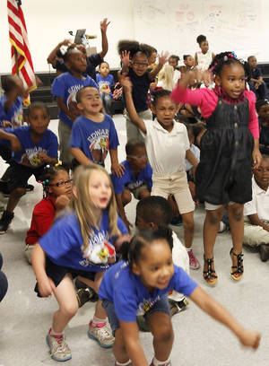 Photo - Students jump during a cheer at an assembly, Friday, May 18, 2012. nDepth package about Edwards Elementary School. Photo By David McDaniel/The Oklahoman