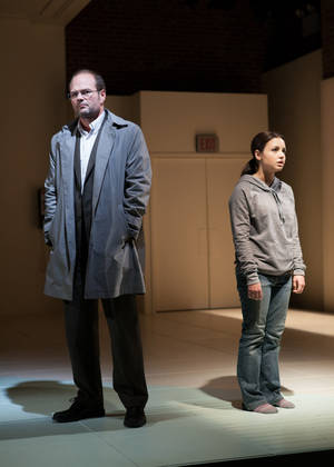 "Photo - This publicity photo released by Boneau/Bryan-Brown shows Chris Bauer, left, and Aimee Carrero in a scene from ""What Rhymes With America,"" a new play by Melissa James Gibson premiering off-Broadway at the Atlantic Theater Company. (AP Photo/Boneau/Bryan-Brown, Kevin Thomas Garcia)"