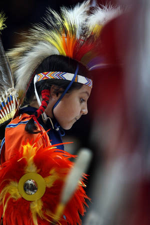 Photo -  Sokobi Connywerdy, 9, waits to dance as the Oklahoma Fancy Dancers perform at the Sam Noble Oklahoma Museum of Natural History. PHOTO BY STEVE SISNEY, THE OKLAHOMAN  <strong>STEVE SISNEY -   </strong>