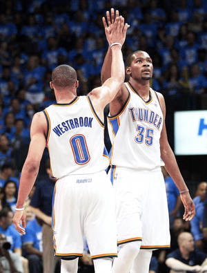 Photo - Russell Westbrook and Kevin Durant. <strong>Sue Ogrocki - AP</strong>