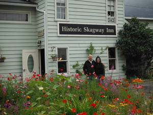 Photo - In this Aug. 2012 photo, Karl and Rosemary Klupar stand outside their business, The Historic Skagway Inn, in Skagway, Alaska. The bed and breakfast was used as a brothel during the gold rush days in the late 1800s. (AP Photo/Capital City Weekly, Amanda Compton)