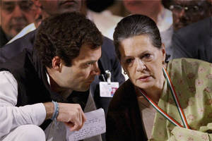 Photo - India's Congress party leader Rahul Gandhi, left, talks to his mother and party president Sonia Gandhi at a meeting of the party in Jaipur, India, Sunday, Jan. 20, 2013. Rahul Gandhi, the scion of India's Nehru-Gandhi political dynasty, was Saturday appointed the party vice president. The elevation positions him to lead the party, which his family has long dominated, in parliamentary elections next year.(AP Photo)