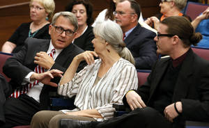 Photo - Greg Heiple, Lynne Miller, and Stephen Tyler Holman sit in the audience before they are sworn in as city council members. <strong>STEVE SISNEY - THE OKLAHOMAN</strong>
