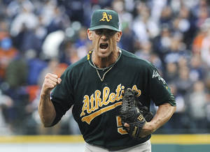 Photo - Oakland Athletics relief pitcher Grant Balfour clenches his fist after the final out Game 3 of an American League baseball division series against the Detroit Tigers in Detroit, Monday, Oct. 7, 2013. Oakland won 6-3. (AP Photo/Lon Horwedel)