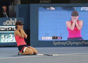Photo - Tsvetana Pironkova of Bulgaria drops to her knees as she celebrates winning her finals match against Angelique Kerber of Germany during the Sydney International Tennis Tournament in Sydney, Australia, Friday, Jan. 10, 2014. (AP Photo/Rob Griffith)