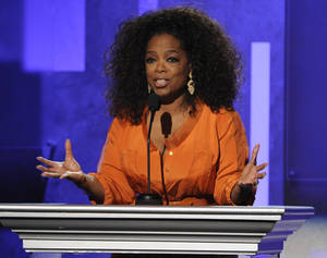 "Photo - FILE - This Feb. 22, 2014 file photo shows Oprah Winfrey speaking at the 45th NAACP Image Awards  in Pasadena, Calif. Winfrey's latest book project will be""What I Know for Sure"" a collection of her magazine columns she wrote for O, the Oprah Magazine. Flatiron Books, a new nonfiction imprint of Macmillan, announced Wednesday, March 12, that the book will come out Sept. 2. It will be the imprint's first release. (Photo by Chris Pizzello/Invision/AP, File)"