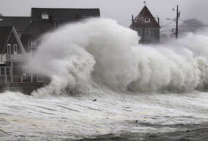 photo -   Waves crash into a seawall and buildings along the coast in Hull, Mass., Wednesday, Nov. 7, 2012. A high-wind warning is in effect in the state until Wednesday night, with gusts of up to 60 mph expected in some costal areas, and 50 mph gusts expected for Boston and western Massachusetts. (AP Photo/Steven Senne)
