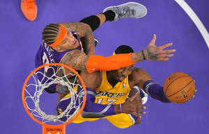 Photo -   Los Angeles Lakers center Dwight Howard, right, puts up a shot as Phoenix Suns forward Michael Beasley defends during the first half of their NBA basketball game, Friday, Nov. 16, 2012, in Los Angeles. (AP Photo/Mark J. Terrill)