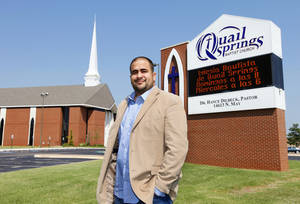 Photo - The Rev. Felix Cabrera, pastor of Iglesia Bautista de Quail Springs at Quail Springs Baptist Church, stands outside the church at 14613 N May.  <strong>PAUL B. SOUTHERLAND - PAUL B. SOUTHERLAND</strong>