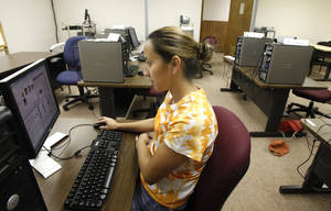 photo - Maribel Flores uses a computer in Oklahoma City Community College's Capitol Hill Center. The college is temporarily using classroom space in Capitol Hill United Methodist Church. Photo By Steve Gooch, The Oklahoman