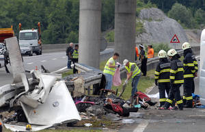 Photo -   Police and firefighters survey the scene of the bus crash near Gospic, Croatia, Saturday, June 23, 2012. At least seven Czech tourists were killed and 44 injured in a bus crash on a major highway in Croatia early Saturday, police said. The accident happened some 200 kilometers (124 miles) south of Zagreb, on the highway connecting the Croatian capital with the central Adriatic coastal city of Split. (AP Photo) CROATIA OUT