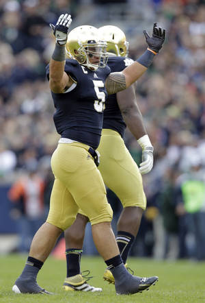 Photo -   Notre Dame linebacker Manti Te'o celebrates after an interception against the BYU during the first half of an NCAA college football game in South Bend, Ind., Saturday, Oct. 20, 2012. (AP Photo/Michael Conroy)