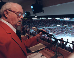 photo -   In a May 2002 photo Budd Lynch, the Detroit Red Wings' announcer, works a game in Detroit. The Detroit Red Wings said Tuesday Oct. 9, 2012, the team's longtime public address announcer Budd Lynch has died. He was 95. (AP Photo/Detroit Free Press,J. Kyle Keener ) DETROIT NEWS OUT; NO SALES: MANDATORY CREDIT