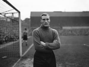 Photo - FILE - This is a  Nov. 12, 1946, file photo,  of England and Wolverhampton Wanderers goalkeeper Bert Williams as he poses for photographers before the start of a soccer match in England. Williams, the England goalkeeper who conceded the goal that allowed a team of journeymen Americans to produce a great upset at the 1950 World Cup, has died. He was 93.  Williams' death was announced Sunday Jan. 19, 2014 on the website of his former club Wolverhampton Wanderers. No cause of death was given.   (AP Photo/File)