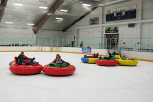Photo - This Dec. 26, 2012 photo shows bumper cars on ice at Howelsen Ice Arena in Steamboat Springs, Colo. The activity is one of a number of relatively new diversions being offered in winter recreation destinations, along with airboarding, snow bikes and snowkiting. (AP Photo/Karen Schwartz)
